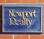 The Newport Realty Logo plaque from in front of our head office.
